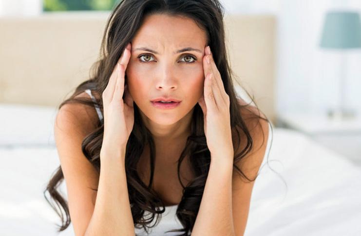 Менструальная мигрень перед месячными: причины сильных болей
