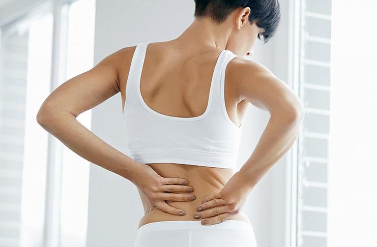 Болит спина перед месячными